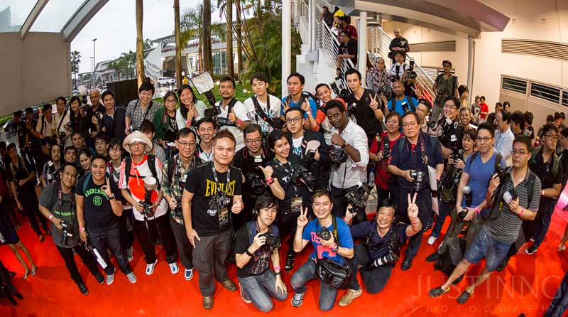Photographers who braved the heavy rain to make it to the red carpet area on 7 November 2014 to support the ONE FC event. Credit: Max