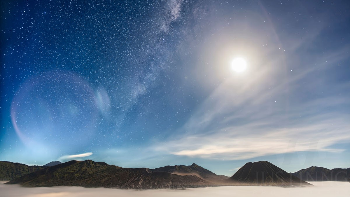 Milky Way against a full moon at Mount Bromo