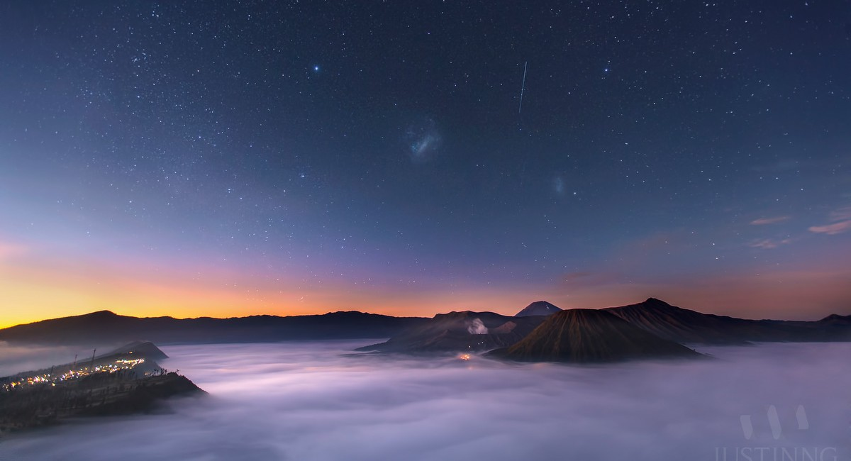 Magellanic Clouds above Mount Bromo during sunrise